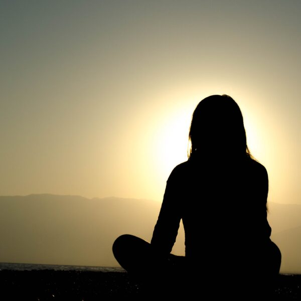 Silhouette of someone meditating