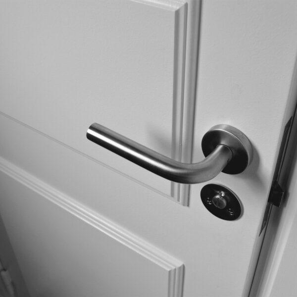 Semi-open white wooden door