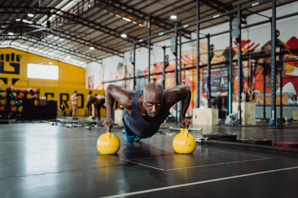 Man doing push-ups using kettlebells