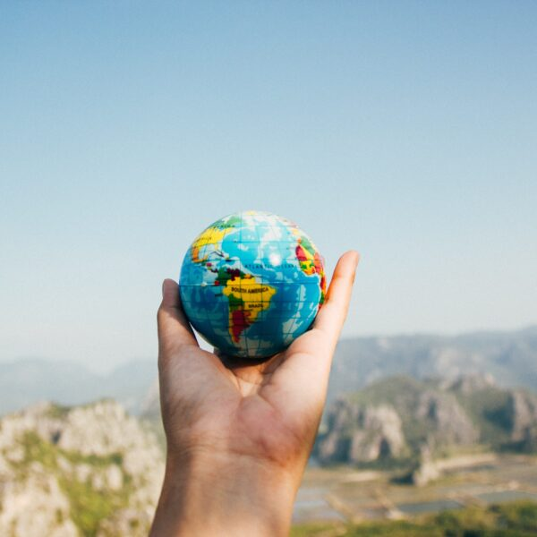 Person holding globe