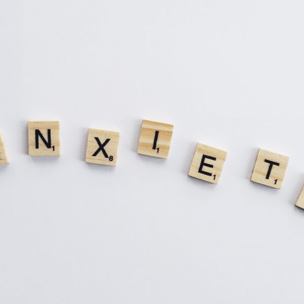Scrabble pieces that spell out 'anxiety'