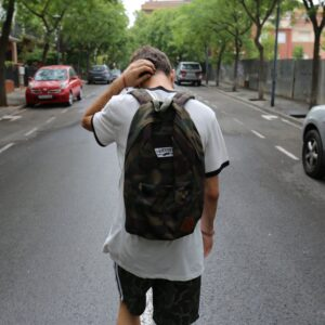 Teen walking down street in Spain