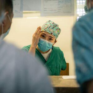 Doctors wearing masks having a meeting