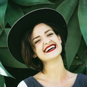 Smiling woman wearing a hat