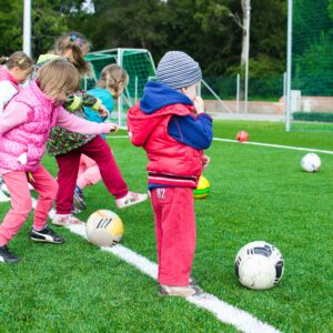 Toddlers playing soccer