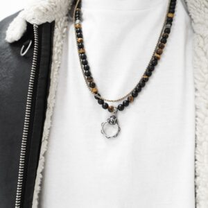 Person wearing necklaces
