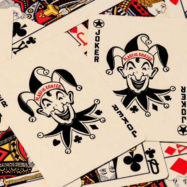 Jokers on top of a deck of cards