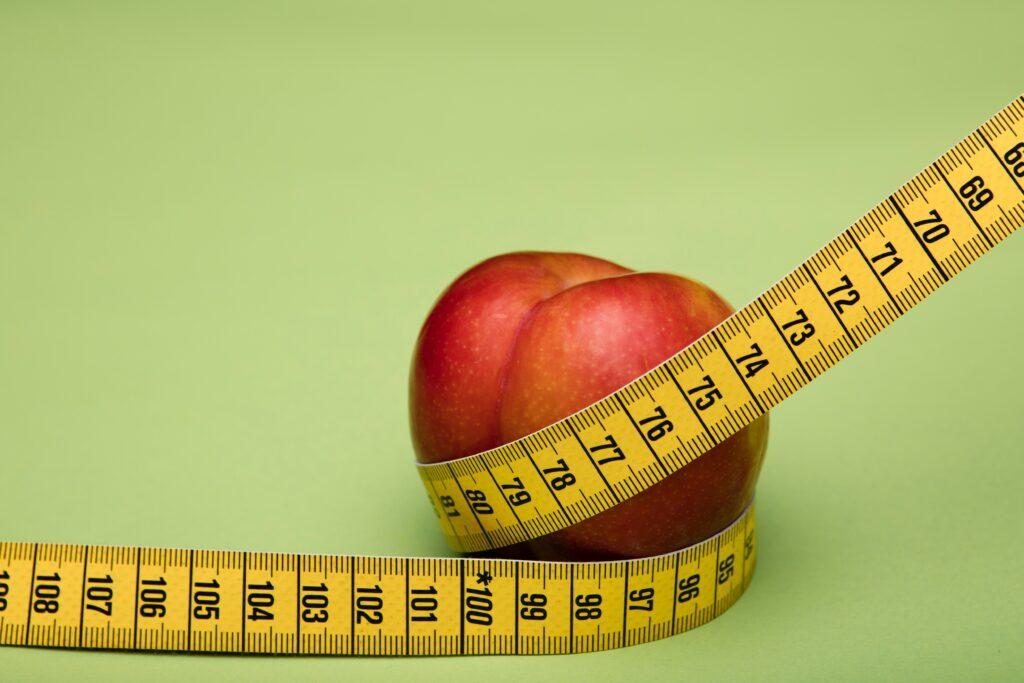 Tape measure wrapped around fruit