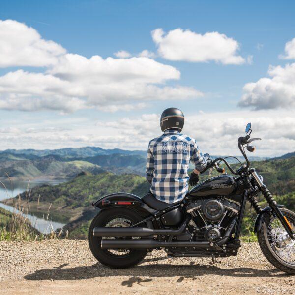 Man sat on a Harley-Davidson motorcycle