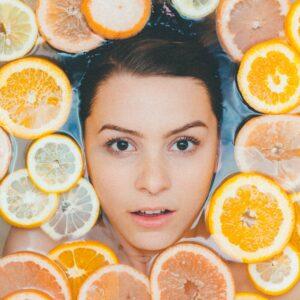 Woman in a bath tub of fruit