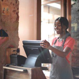 Female cashier using computer