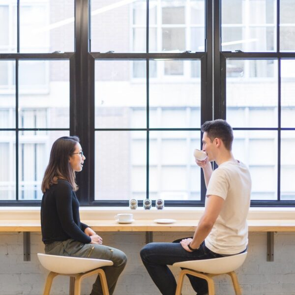 Man and woman having a cup of coffee