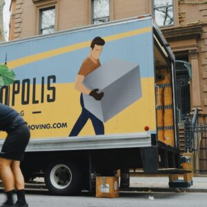 Moving men in front of a moving van