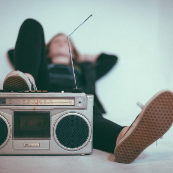 Person relaxing and listening to music