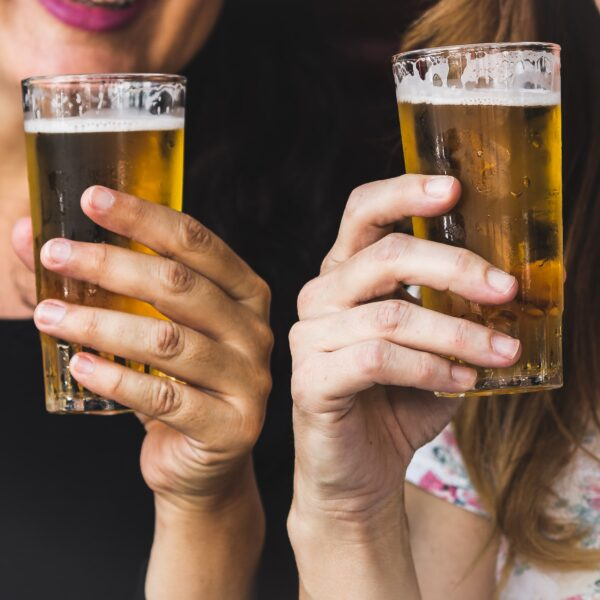 Two women drinking beer