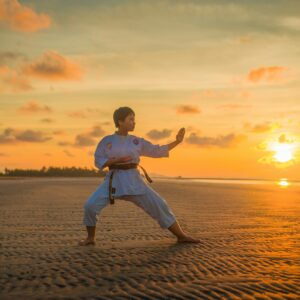 Boy doing karate during the golden hour