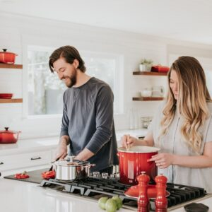Man and woman cooking in a kitchen