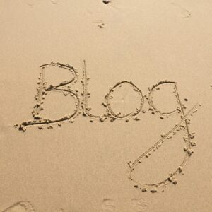'Blog' written in sand