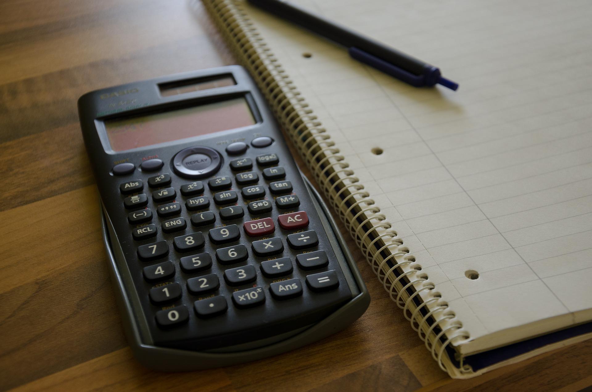 Casio calculator, notebook and pen