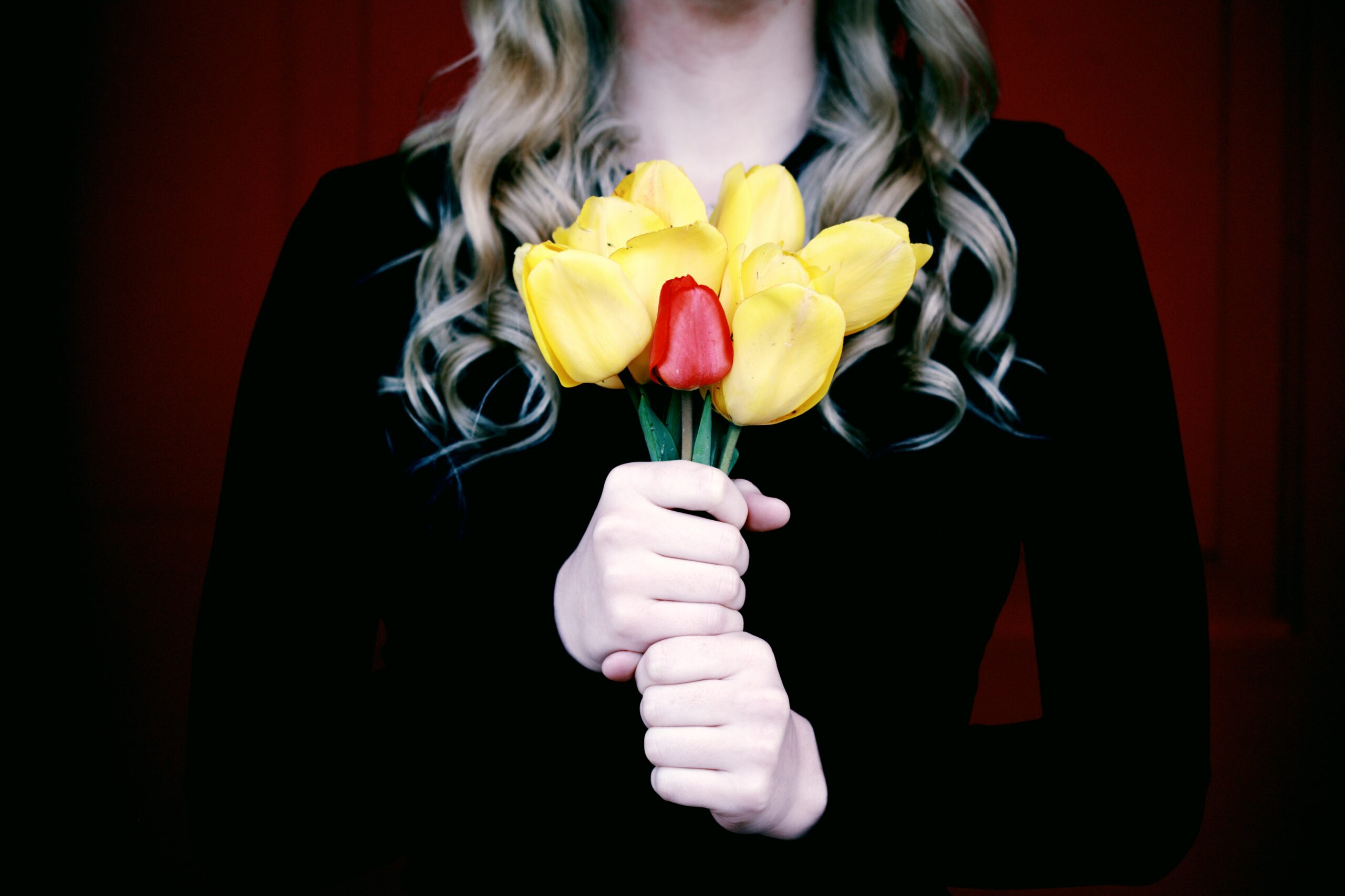 Woman holding a small bouquet of tulips