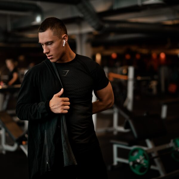 Man putting on jacket at the gym