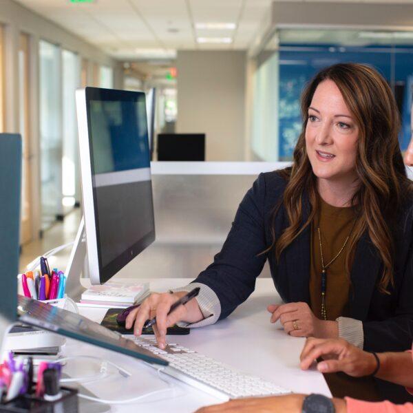 Two businesswomen using a computer