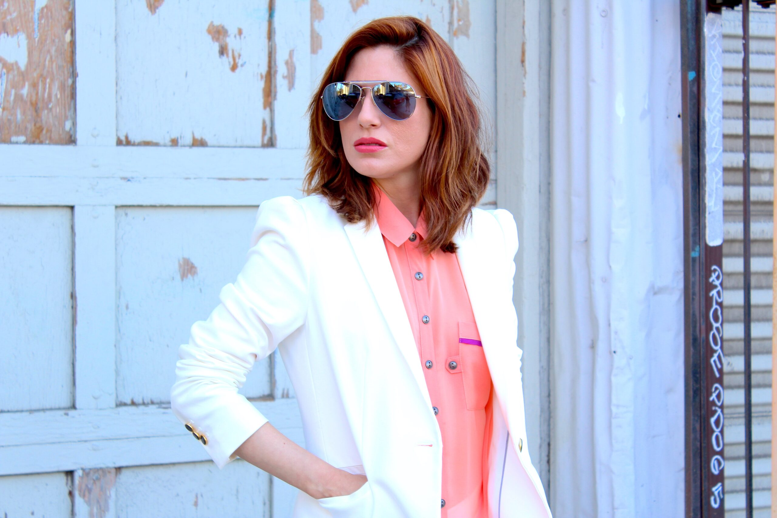 Woman wearing a Miami Vice inspired outfit
