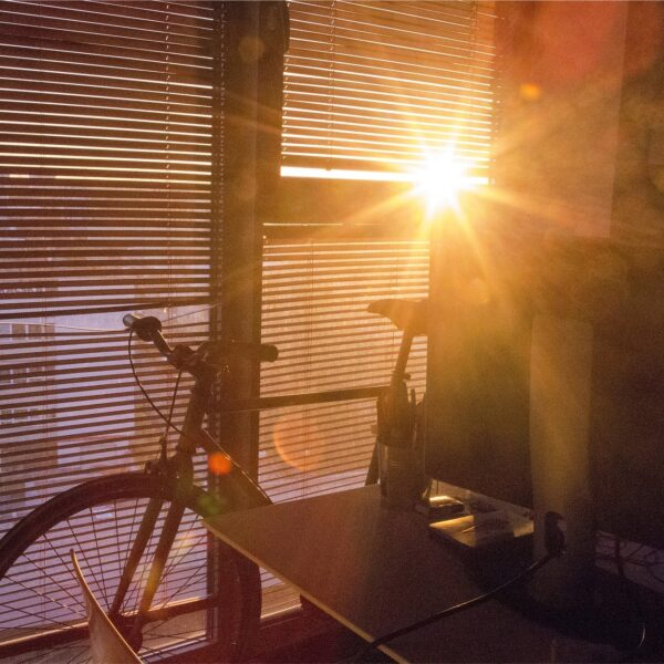 Bicycle in front of blinds