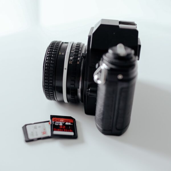 A digital camera and two SD cards