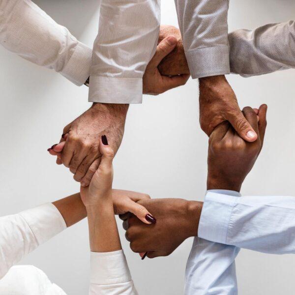 People interlocking hands