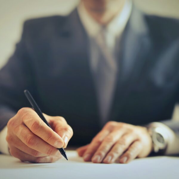Businessman signing a contract in an office