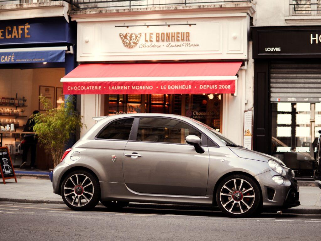 Silver sedan outside of Le Bonheur in Paris, France
