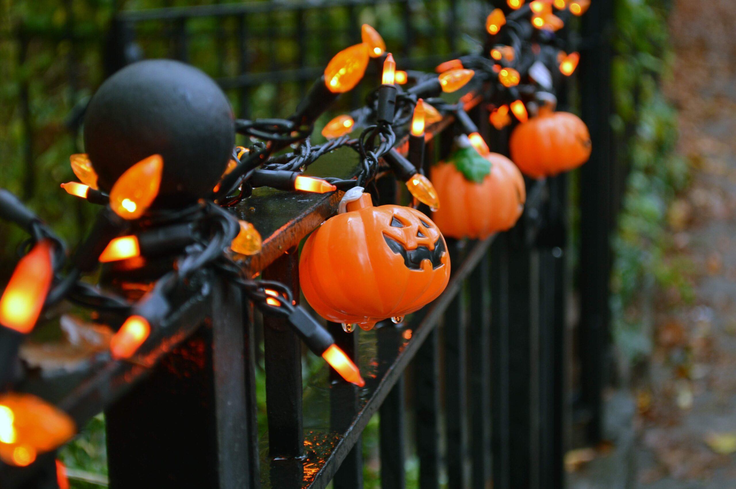 Jack-o'-lantern lights on a railing