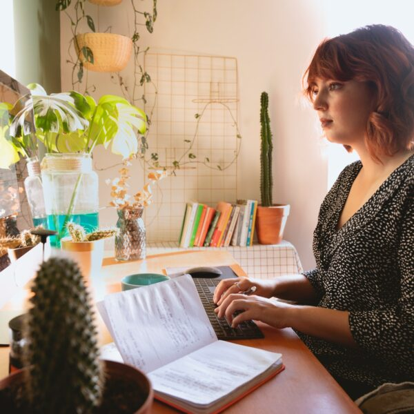 A woman typing on her computer in her home office