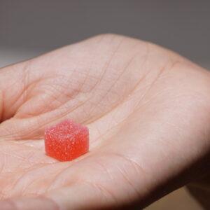 CBD gummy on a palm