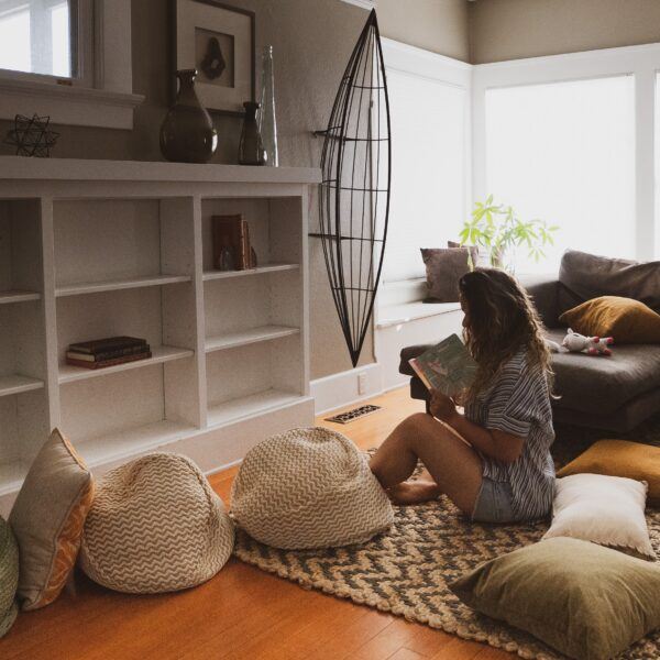 Woman reading a book in a living room