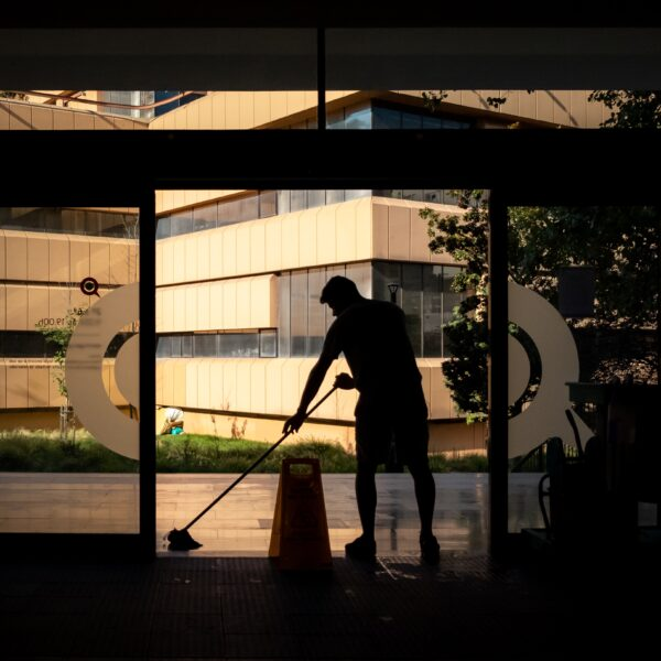 Man cleaning floor of entrance