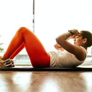 Woman exercising on a mat