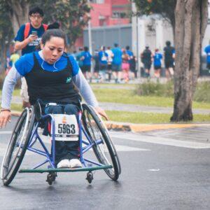 Woman in a wheelchair during a marathon