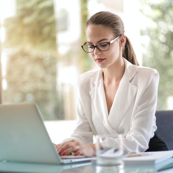 Business woman typing on a laptop