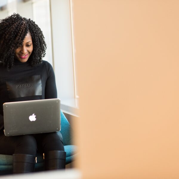 Woman using a MacBook on her lap